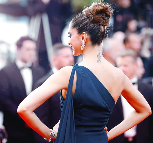 Deepika Padukone Keeps It Classy & Flaunts Her 'RK' Tattoo Like A Boss On Day 2 Of Cannes!