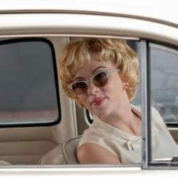 Scarlett Johansson caught kissing French journalist