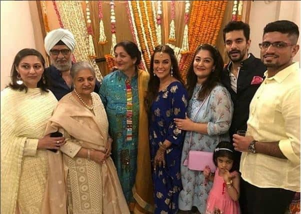 Neha and Angad pose with family after their Mehendi -