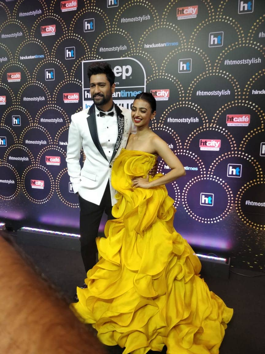 The glamorous hosts for the evening are here and ready. Vicky Kaushal and Radhika Apte pose at the red carpet of India
