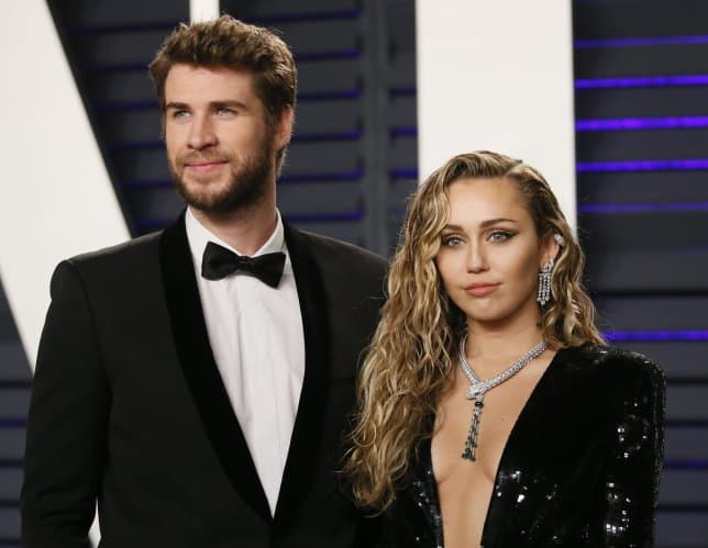 Liam Hemsworth Confirms Split With Miley Cyrus Wishes Her Happiness and Health