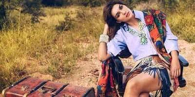 Kriti Sanon Trolled Brutally For Posing With Giraffe; Magazine Comes To The Rescue